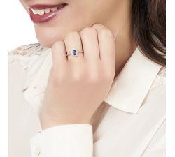 Anillo de compromiso Lady Diana: Zafiro rodeado de diamantes